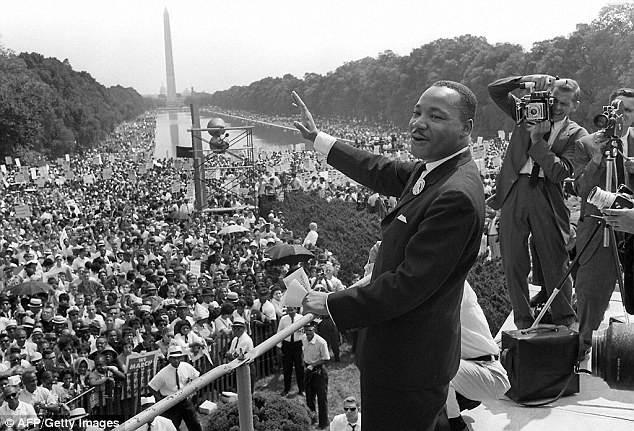For the first time, a court used the 1964 Civil Rights Act to rule that LGBT employees are protected from workplace discrimination. Pictured:Martin Luther King, whose marches against racism prompted Congress to pass the landmark civil law