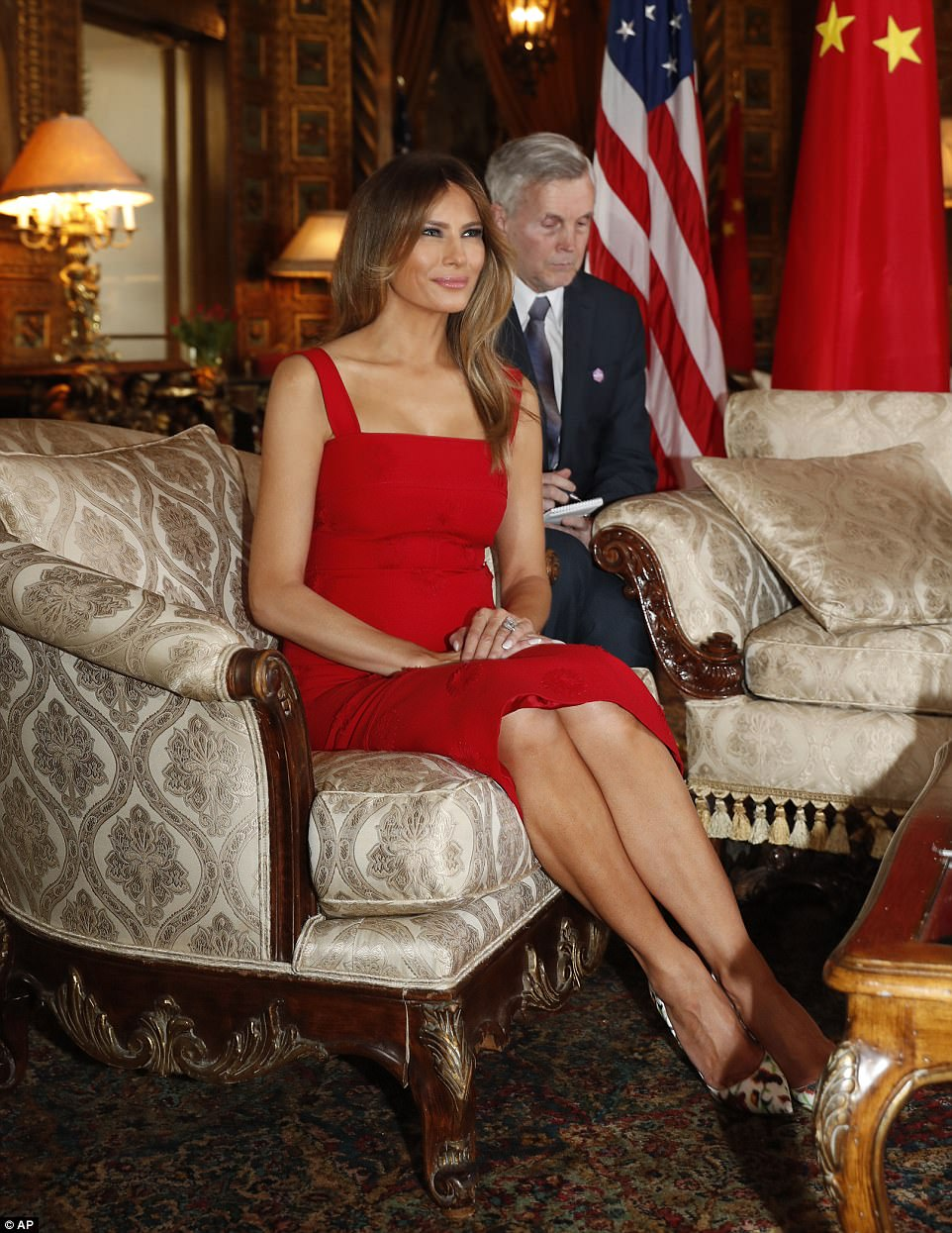 Pictured, Melania in a striking red tea-length dress just one day after she welcomed the King and Queen of Jordan at the White House