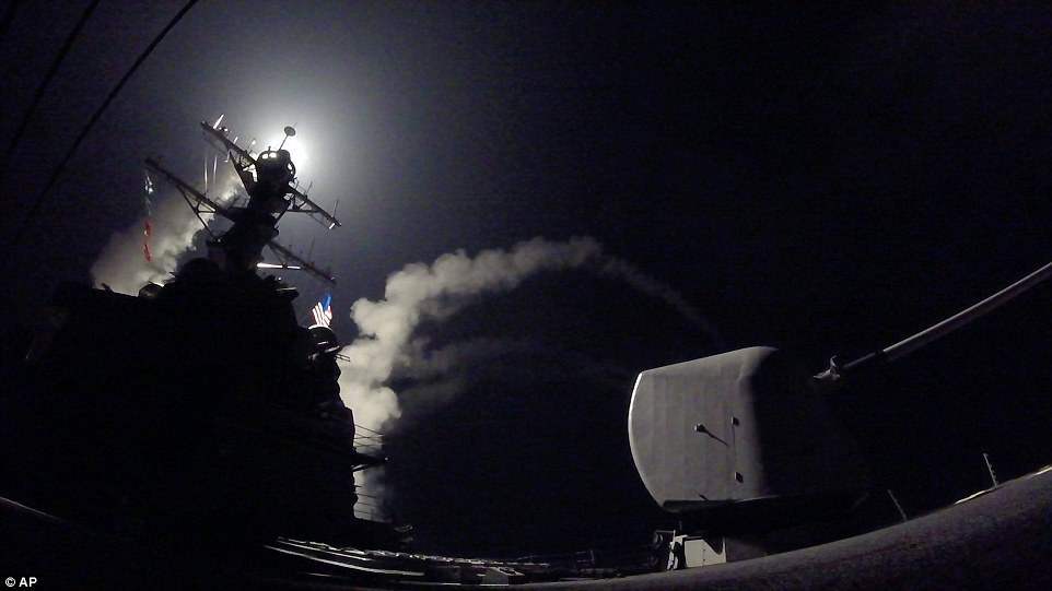 The guided-missile destroyer USS Porter (DDG 78) launches a tomahawk land attack missile in the Mediterranean Sea