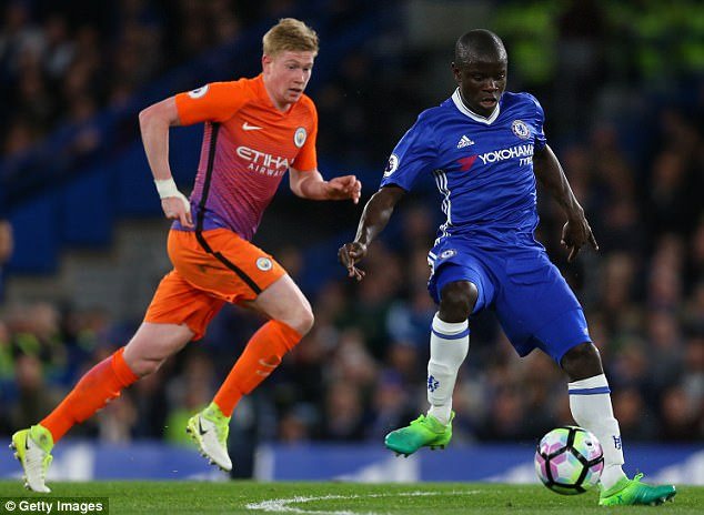 Chelsea midfielder N'Golo Kante (right) plays a pass under pressure from Kevin De Bruyne