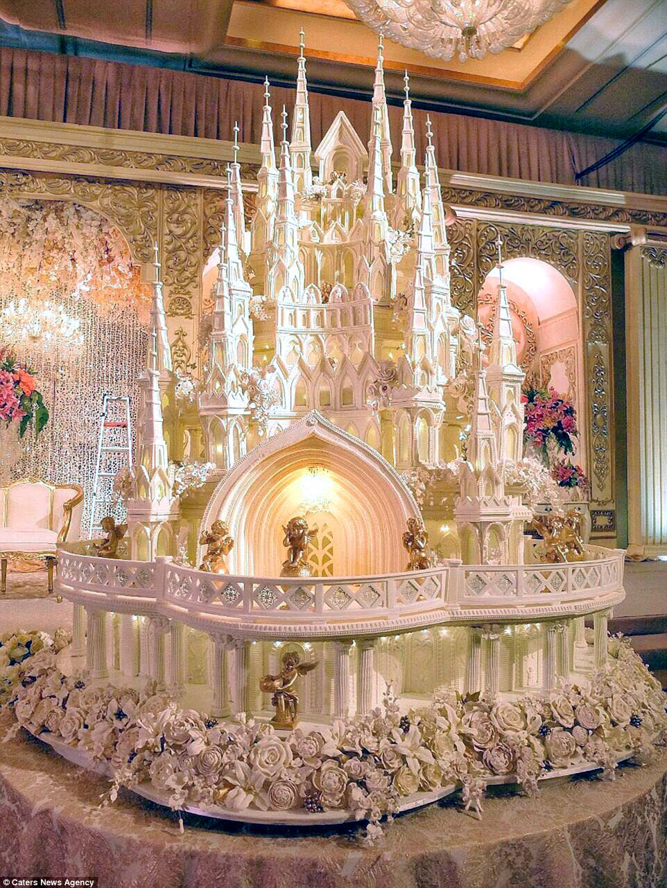 Are these the most elaborate wedding cakes of all time    Daily Mail     This cathedral wedding cake has been decorated with hundreds of delicate  sugar flowers  some of