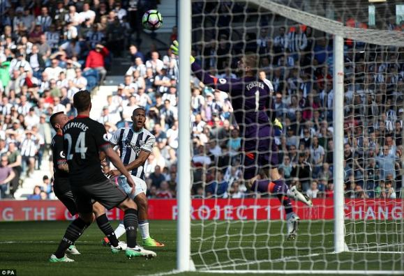 West Brom striker Salomon Rondon sees his goalbound header clawed out by Southampton No 1 Fraser Forster