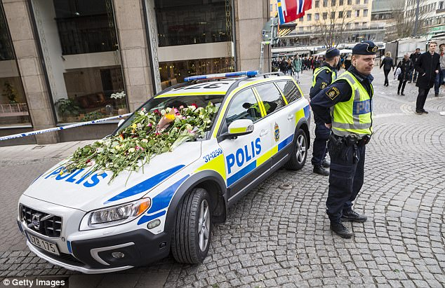 Flowers left on a police car today as a sign of gratitude for the hard work of officers at the scene of the terrorist truck attack in downtown Stockholm