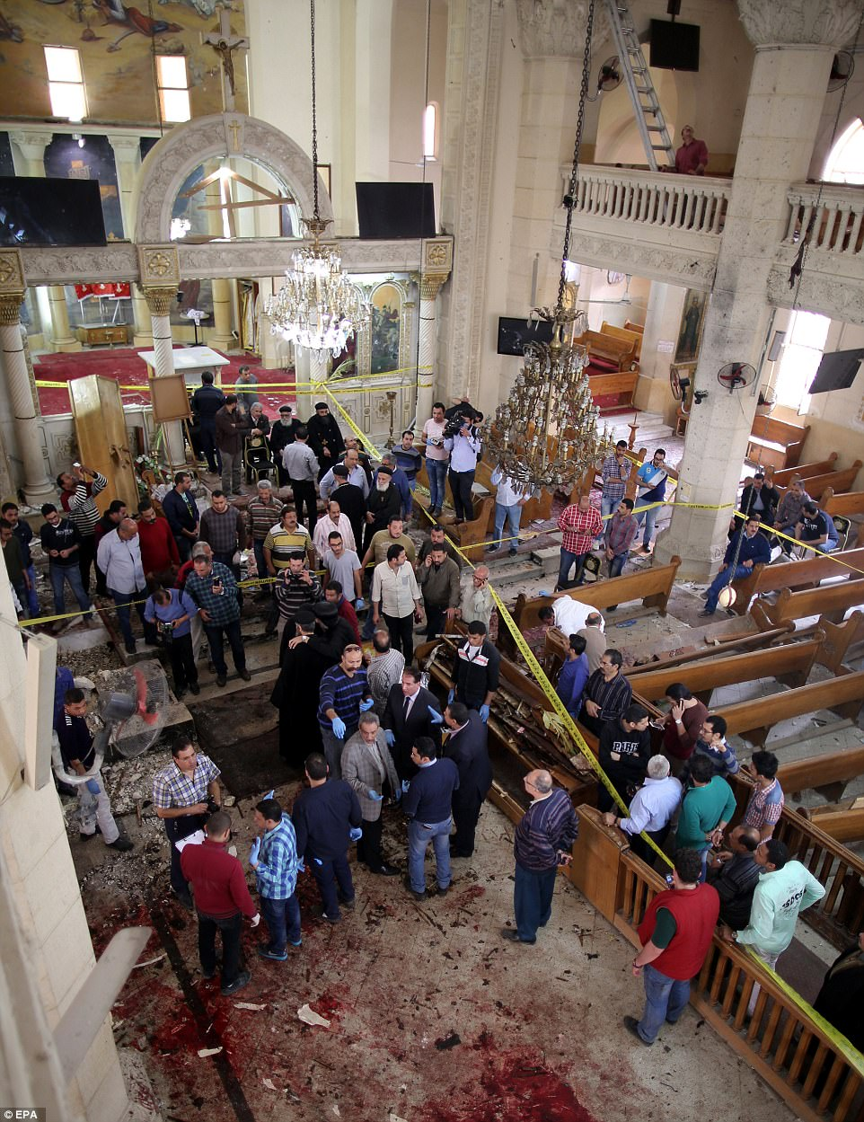Nearly four dozen people were killed after two explosions targeting Coptic Christians in Tantra and Alexandria today. Pictured, the blood covered floor in St. George's Church in Tanta