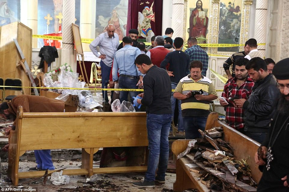 Forensic officers began gathering evidence from the site of the suicide blast in Tantra, 75 miles north of Cairo