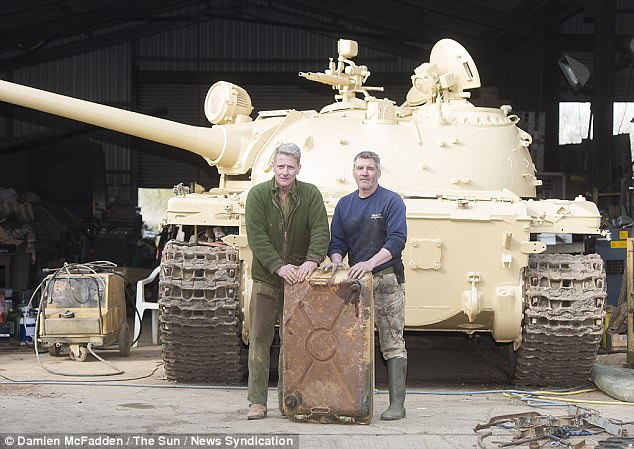 Nick Mead (pictured left) and mechanic Todd Chamberlain with the tank. They found the gold inside the diesel tank, which they had just removed