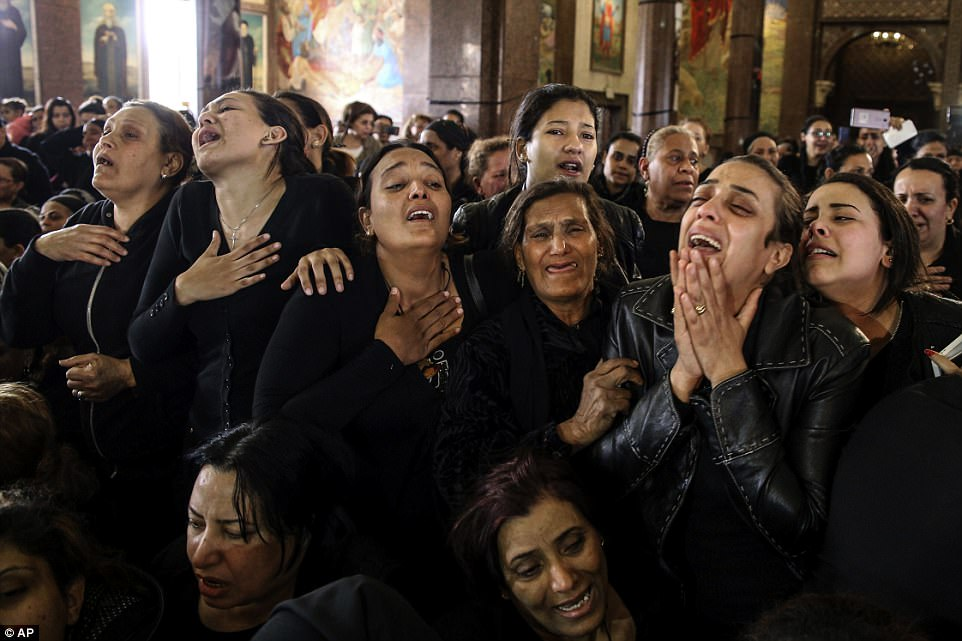 Devastated families of worshippers killed in an ISIS bomb attack in Egypt on Palm Sunday wept as they carried the coffins of their loved ones today