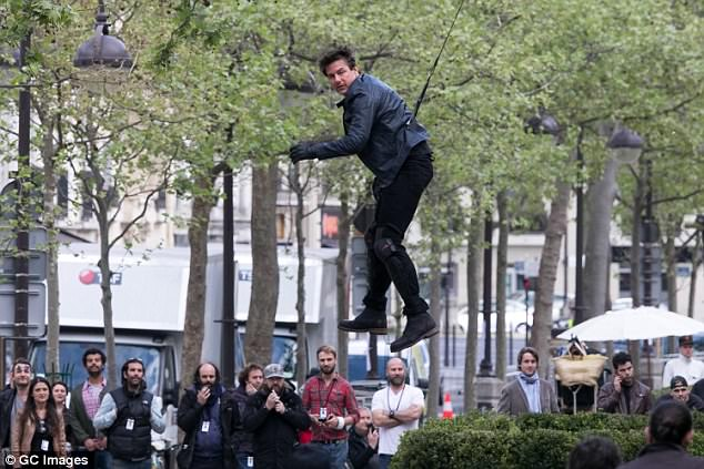 Precarious! Tom was seen suspended in the air as they filmed dramatic scenes