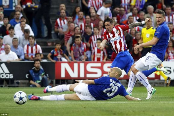 Former Liverpool striker Fernando Torres takes a strike at the Leicester goal as Atletico dominate the opening proceedings