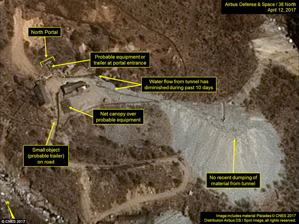 Satellite imagery of the Punggye-ri Nuclear Test Site taken on April 12 appears to show vehicles  parked around the North Portal of the site.North Korean monitoring service 38 North said the facility is 'primed and ready' for a sixth nuclear test