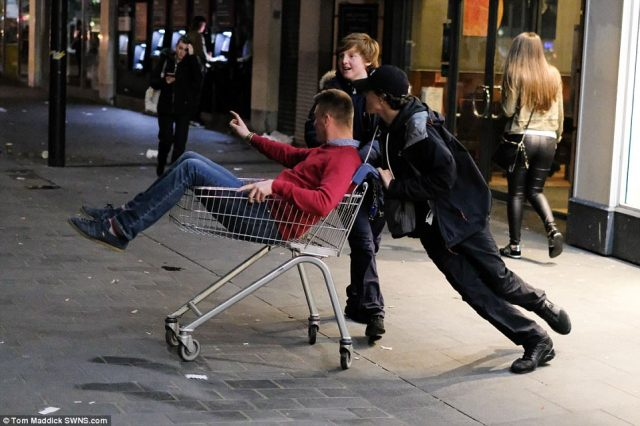 While some let their hair down, others took things to extremes by mucking about with shopping trolleys in the busy streets