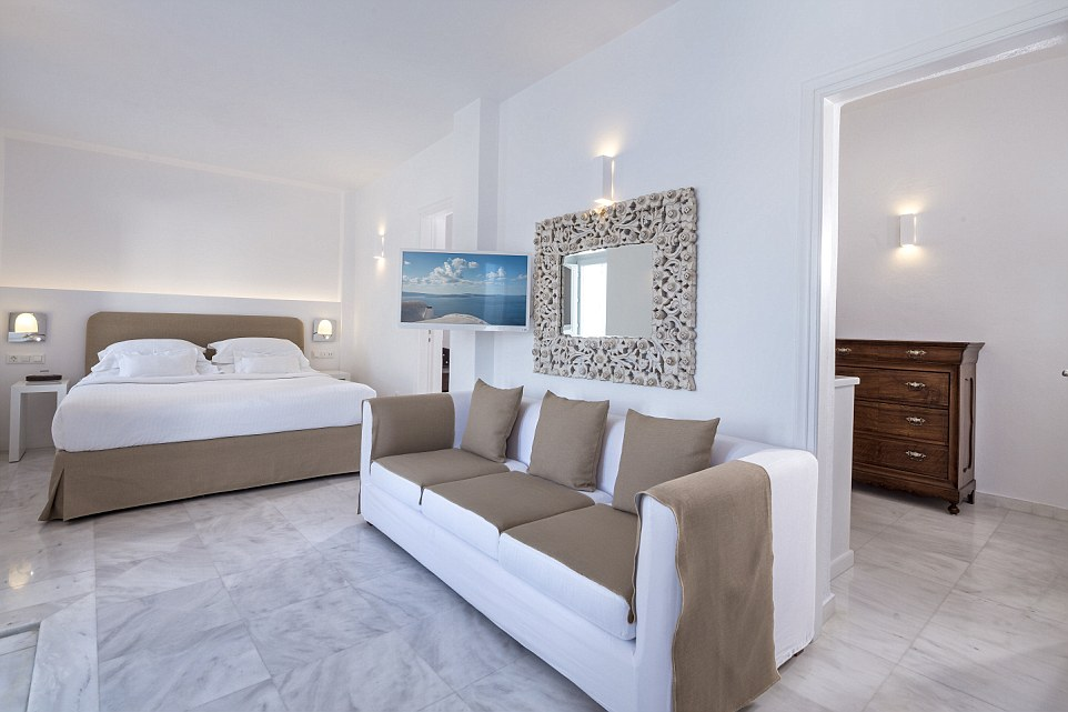 The rooms at Canaves Oia are simply, but elegantly, furnished