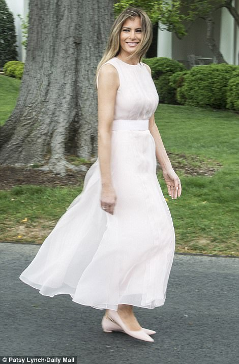 The first lady wore an elegant baby pink Hervé Pierre dress with matching pointed flats for the upbeat event