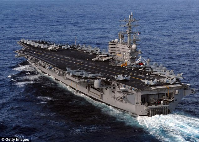 Reports in South Korea claim the US President is bolstering the deployment by sending the USS Ronald Reagan (pictured) and the USS Nimitz to the Sea of Japan next week
