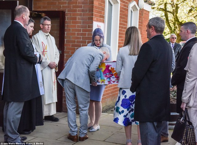 Violet-Grace's father Glenn was pictured kissing his daughter's casket outside the church before the formal service began