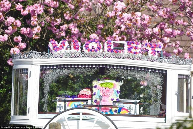A coffin, decorated with rainbows and characters from the animated film Trolls, was brought to St Julie's Church in Eccleston, St Helens, in a horse-drawn carriage