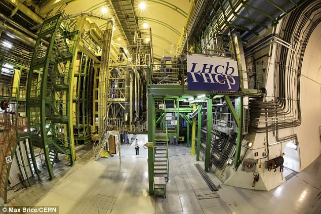 Earlier this year, researchers with Cern's LHCb experiment (pictured) found 'intriguing anomalies', a discovery that has now been used as one of the three pieces of research included in a new Nature review. The review hints at explanations beyond the Standard Model