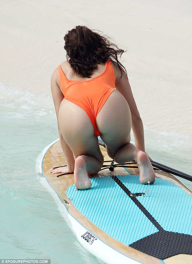 Bottoms up! Chloe flaunted her pert derriere as she climbed onto the board on all fours