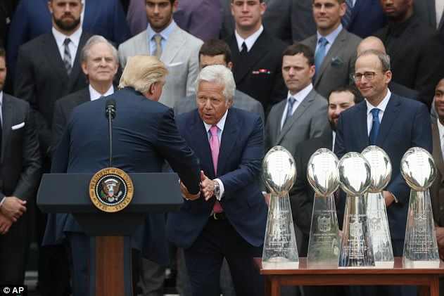 President Trump grabs the hand of New England Patriots owner Robert Kraft during the ceremony on the South Lawn congratulating the team for winning the Super Bowl