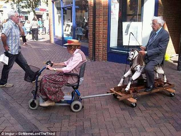 Giddy up: For whatever reason, this elderly woman is towing a male companion on a rocking horse with her mobile scooter. Furthermore, he appears to be brandishing a riding crop