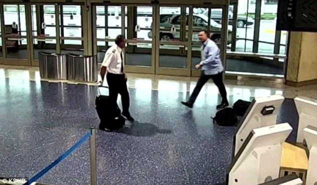 Foster was then seen on video walking towards the pilot (pictured) before he violently shoved him