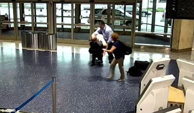 This still image taken from airport surveillance footage shows Foster as he grabbed the off-duty pilot by the arm