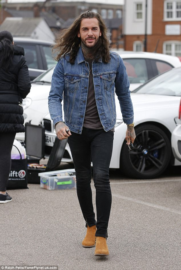 Stepping out: Megan's ex Pete flaunted his long brunette locks as he worked his blue denim shirt and black skinny jeans