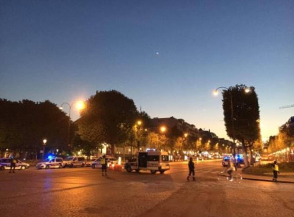 It was originally believed the other officer was seriously wounded while the attacker was killed on the world famous avenue (pictured)