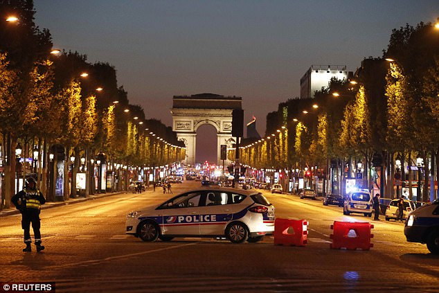 Police closed off the popular avenue (pictured) after a policeman was killed during a shooting incident in the French capital