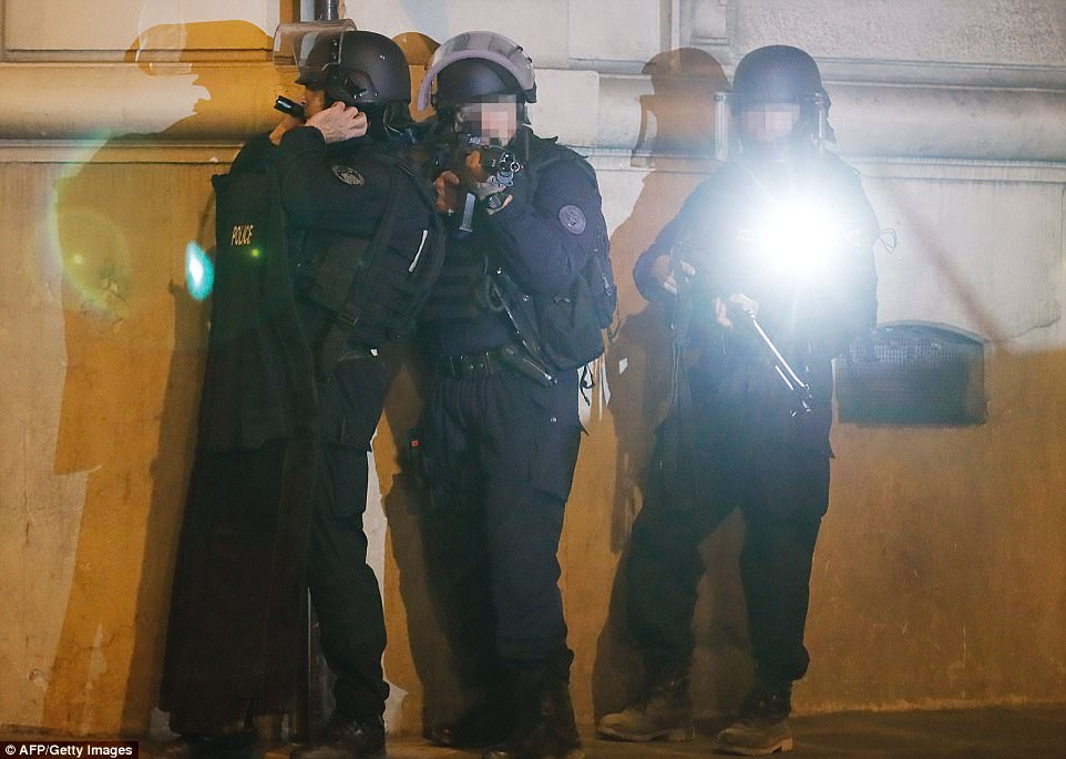 Armed police officers stood guard after they rushed to the scene in the centre of the capital when a police officer was killed