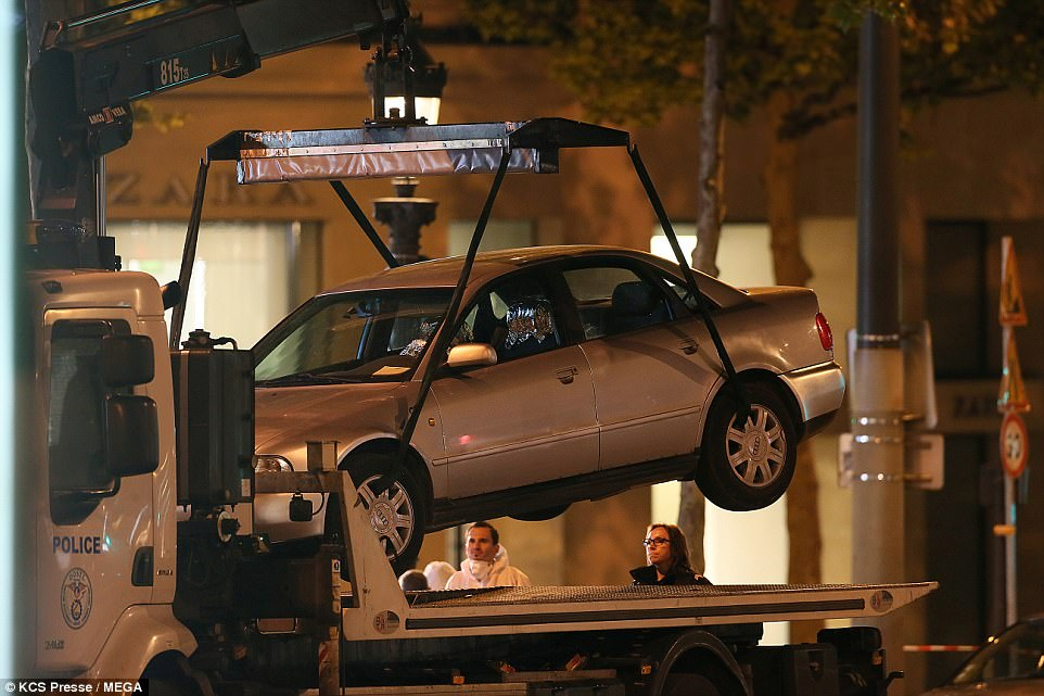 A police lorry seized the Audi which the attacker was driving, before he got out and shot at traffic officers last night