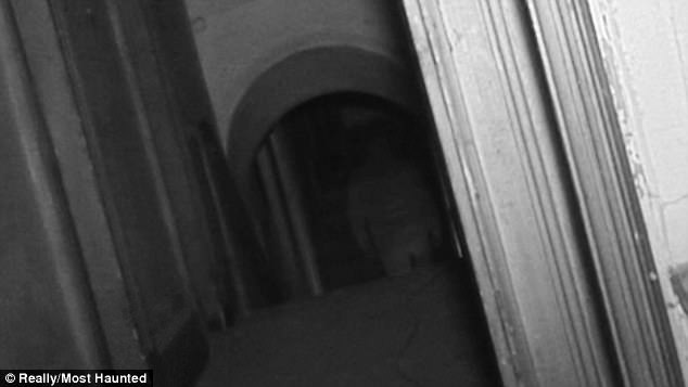 Creepy: A ghostly figure is captured walking through the doorway and into the corridor