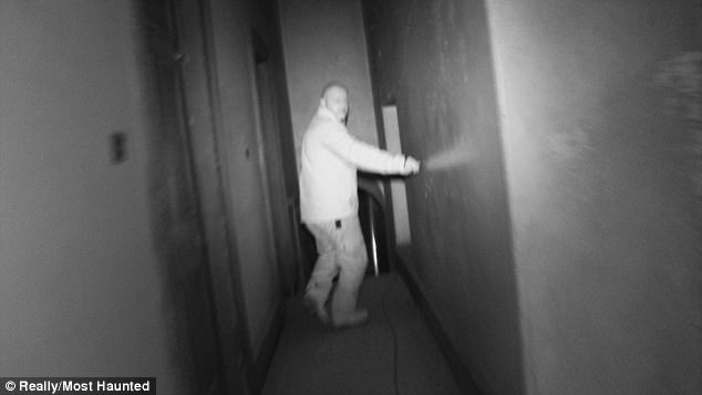 Stuart runs down the corridor in pursuit of the ghostly figure which promptly disappears