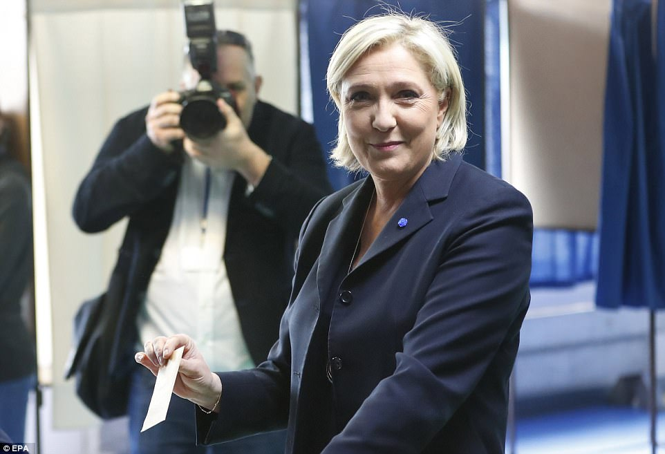 French presidential election candidate for the far-right Front National (FN) party, Marine Le Pen casts her ballot in the first round of the French presidential elections in Henin-Beaumont, Northern France, shortly after the commotion