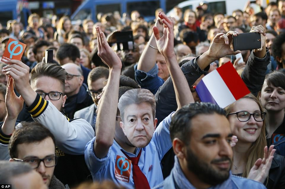 Despite his defeat, supporters for the election candidate far-left leader Jean-Luc Melenchon still cheered for him outside his election headquarters