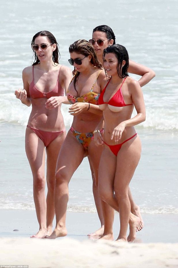Babewatch! Kourtney was not in the least bit shy showing off her amazing figure in the tiny suit; pictured with Larsa Pippen