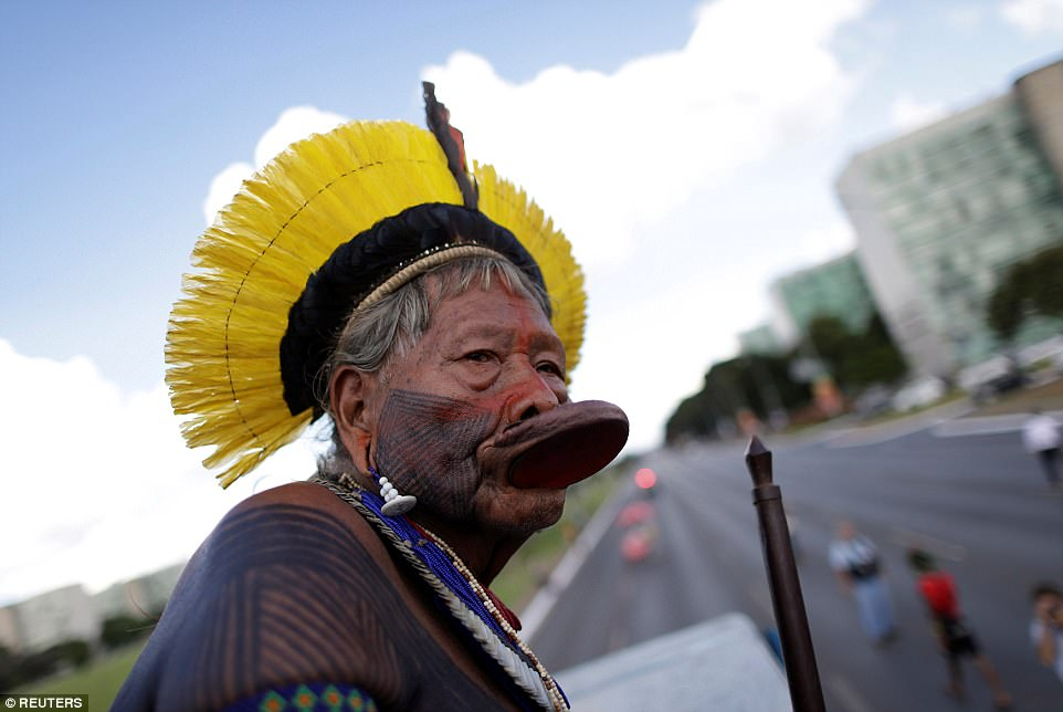 Raoni Metuktire, a leader of the Brazilian indigenous ethnic Kayapo people, gestures as he takes part in a demonstration against the violation of indigenous people's rights, in Brasilia