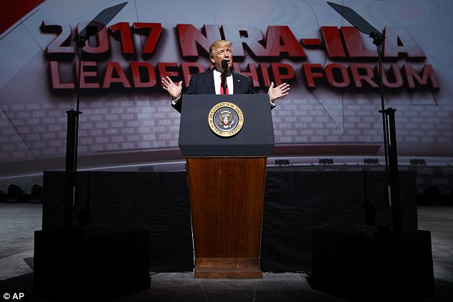 Conquering hero: Trump was cheered on to the stage and applauded repeatedly as he told the NRA:'You have a true friend and champion in the White House.'