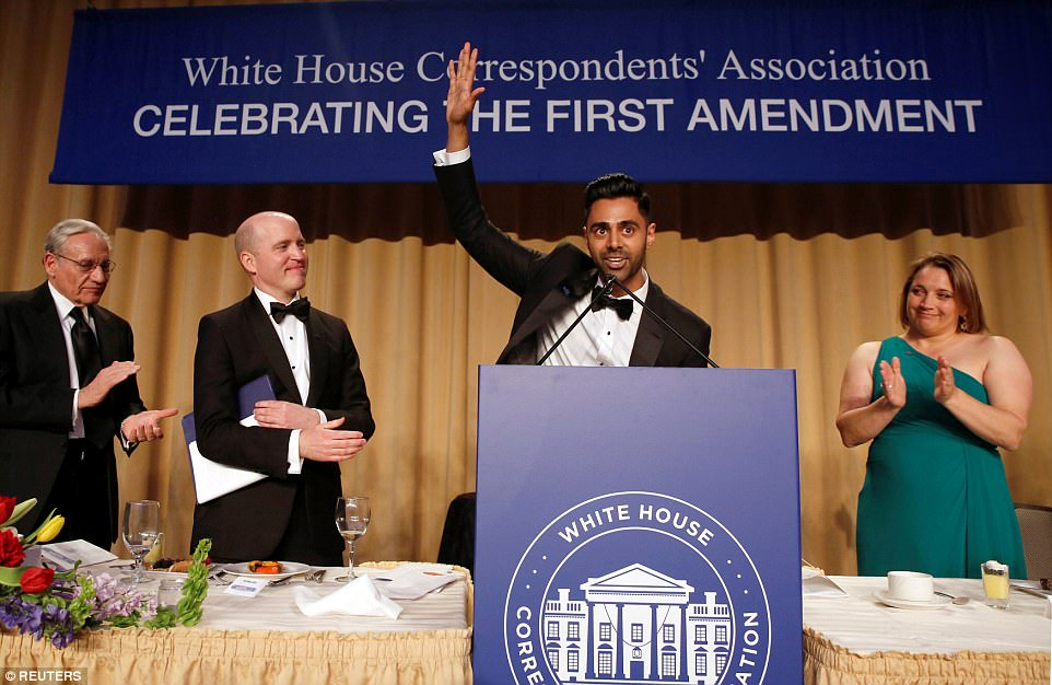 Members of the head table applaud as Hasan Minhaj (2nd R) of Comedy Central finishes his performance at the White House Correspondents' Association dinner