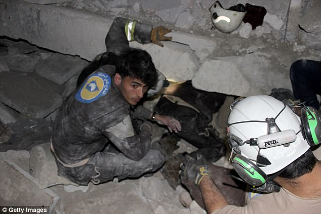 Earlier this month, Human Rights Watch accused the US military of failing to take 'necessary precautions' to prevent civilians deaths in a strike on a Syrian mosque in March that killed dozens of people. Rescuers search for survivors from the rubble in the Aleppo district above
