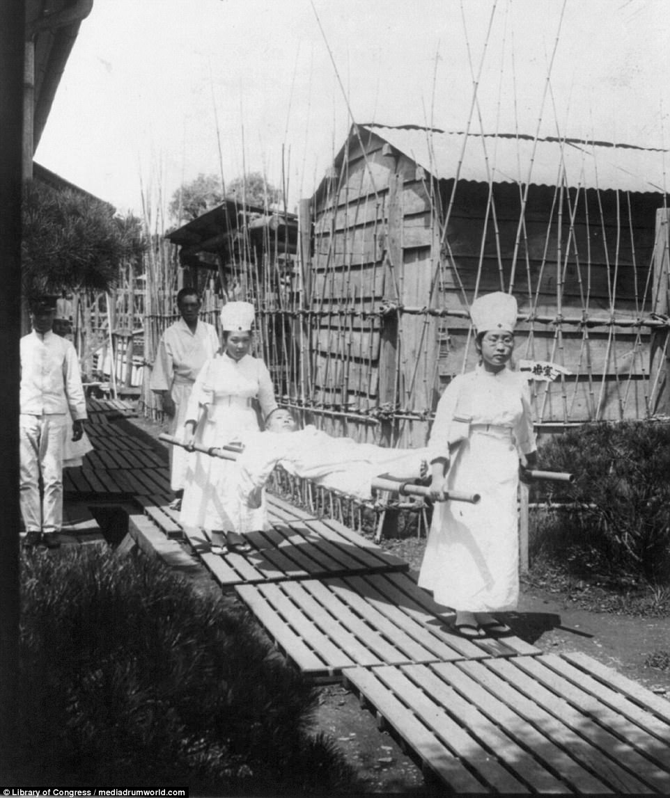 A Japanese fighter is pictured being carried by nurses after being injured during the war. It is estimated that around 47,000 Japanese service personnel were killed in the conflict with Russia