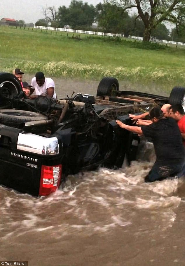 A family were trapped in a flipped truck after tornadoes ripped through Texas