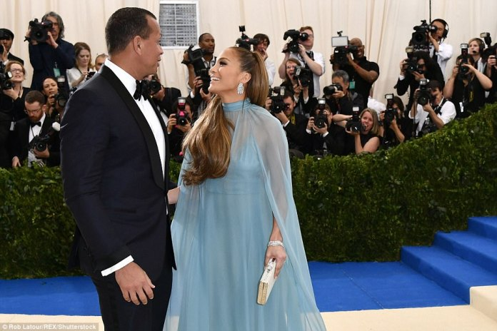 Only got eyes for you! Jennifer Lopez gazes at her new man Alex Rodriguez as the pair pose; this was there first red carpet