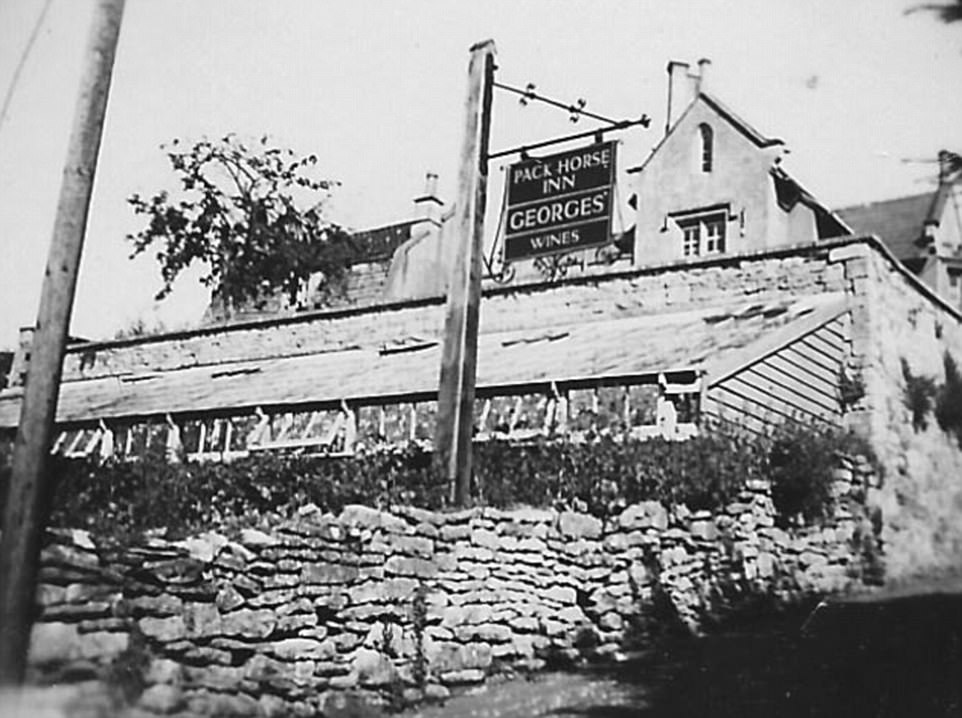A sign outside the entrance of the pub hangs over the green house. The venue was owned by Georges until the end of the 20th century. Historians say the tavern thrived when it was run by local managers