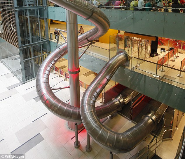 Weee! Singapore's Changi Airport has a slide that stretches over four storeys and speeds travellers from top to bottom at a rate of 19 feet per second