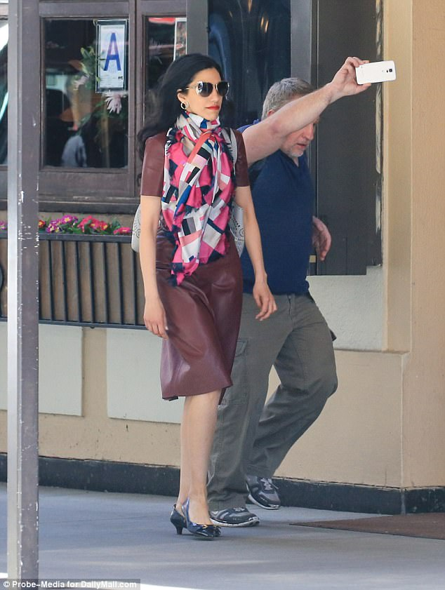 Huma Abedin was captured Thursday, sporting a leather dress and chic skirt, en route to the office of her longtime boss, former Democratic nominee Hillary Clinton