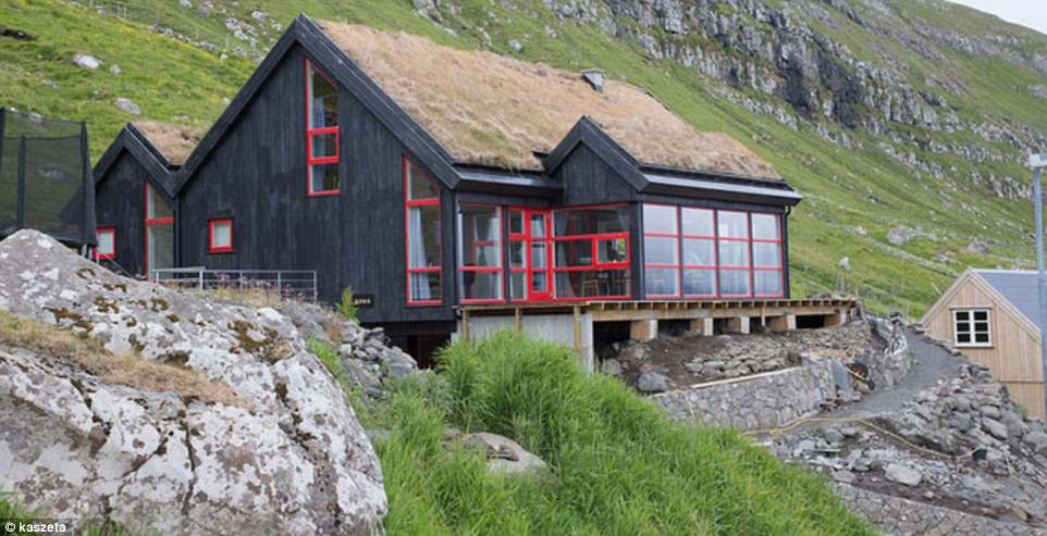 Exterior shot: Koks restaurant is nestled on the sea front in side a cosy wooden lodge, complete with a grass roof