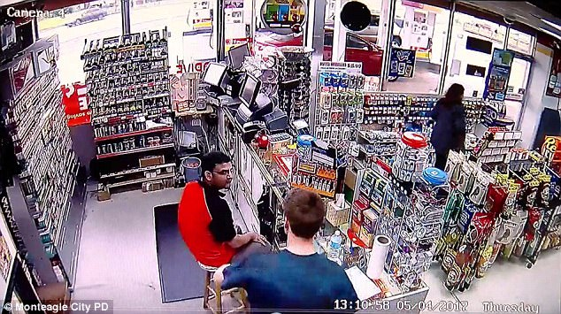 Horrifying surveillance footage shows the moment gas station clerk, Satish Patel (pictured in red) was violently stabbed in Tennessee by carjacking suspect Dylan Hilton (pictured in blue), according to police