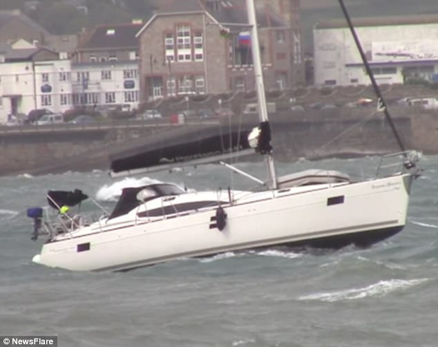 In choppy seas a sailor was forced to navigate tricky conditions as his vessel nearly hit a wall at the harbour in Newlyn, Cornwall
