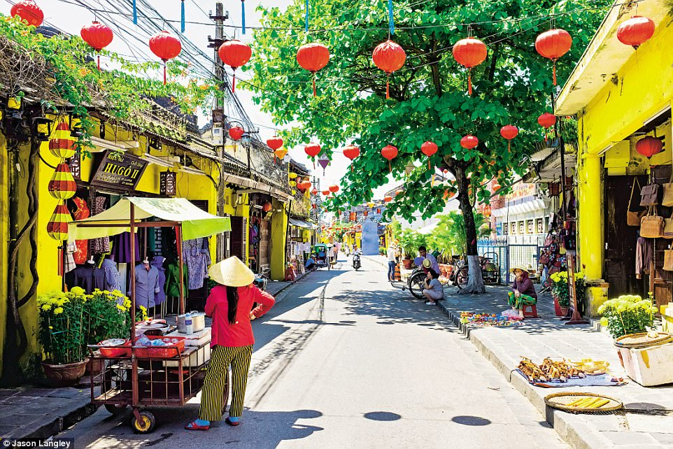 Bright spectacle: The town of Hoi An is full of beautifully preserved buildings